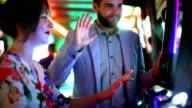 Two people having fun in casino. video