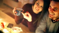 Two people having tea at cabin coffee shop. video