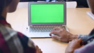 Two People using Laptop with Green screen, Chroma key video