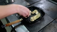 Two pieces of chicken fillet frying on a grill pan video