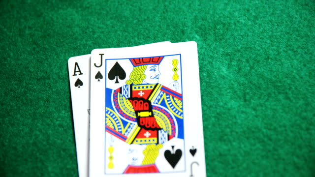 Two playing cards on poker table in casino 4k video