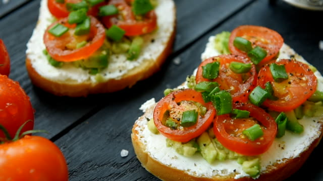 Two ready bruschetta with cream cheese and veggies video