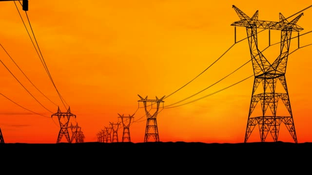 Two rows of electricity pylons. video
