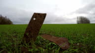 Two rusty old tractor plow iron details in the field, time lapse video
