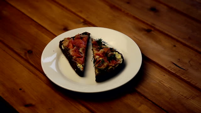 Two sandwiches with red fish on a plate video