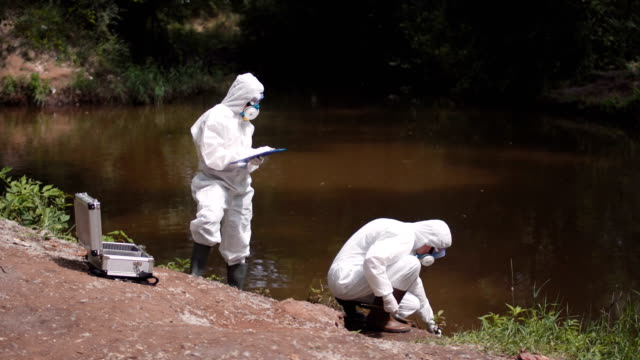 Two scientists taking water samples from a river video