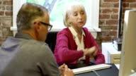 Two Senior Businesspeople Having Meeting In Design Studio video