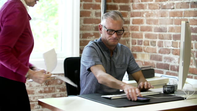 Two Senior Businesspeople Having Meeting In Design Studio video