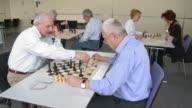HD: Two Senior Men Finishing Game Of Chess video