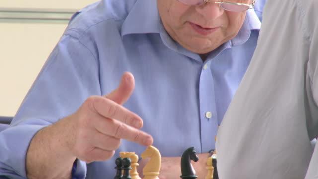 HD: Two Senior Men Playing Chess video