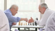 HD: Two Senior Men Playing Chess video