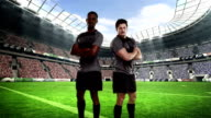Two serious rugby players posing video