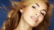 Two shots of Beautiful woman on blue bg video
