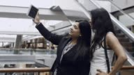 Two Smiling Businesswomen Taking Selfie in Hall video