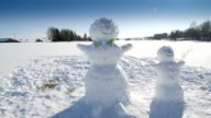 Two snowman on the wide white field video