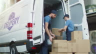 Two Strong Delivery Men Loading Commercial Vehicle Full of Cardboard Boxes. video