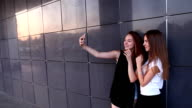Two student female friends takes make photo herself selfie video