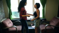 Two student talking in the room video