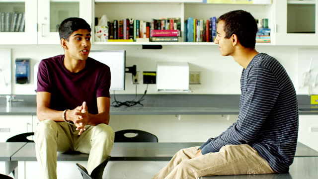Two students in classroom video
