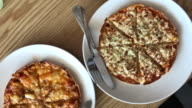 Two style thin crispy pizza in cafe , Bangkok , Thailand. video