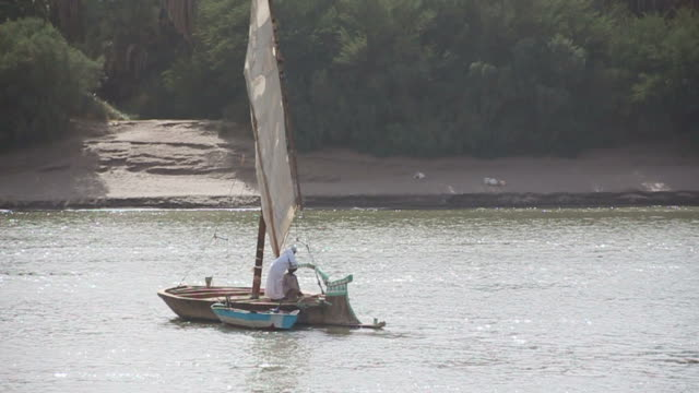 Two Sudanese men lazily sailing down the Nile on Felukka video
