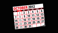 Two Thousand and twelve calendar flicking backwards video
