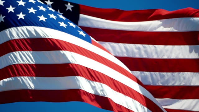 Two videos of American flag in slow motion video