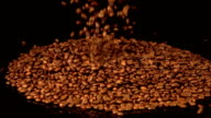 Two videos of falling coffee beans in real slow motion video