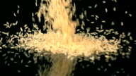 Two videos of falling rice in real slow motion video