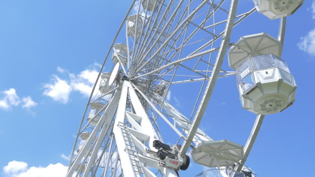 Two videos of ferris wheel in 4K video