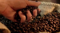Two videos of grabbing coffee beans in real slow motion video
