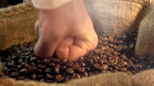 Two videos of hitting coffee beans in real slow motion video
