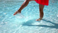 Two videos of legs splashing the water-real slow motion video
