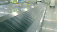 Two videos of luggage carousel in 4K video