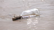 Two videos of message in the bottle in the water-slow motion video