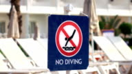 Two videos of no diving sign in real slow motion video