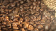Two videos of rotating coffee beans in 4K video