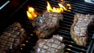 Two videos of steaks on the fire-real slow motion video
