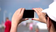 Two videos of taking a picture in real slow motion video