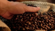 Two videos of taking coffee beans in real slow motion video