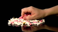 Two videos of taking pills in real slow motion video