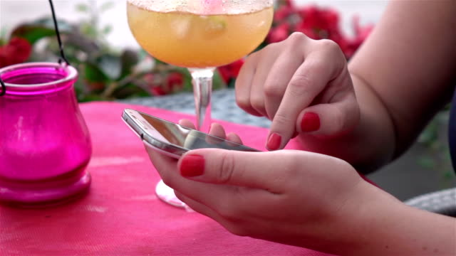 Two videos of woman using cell phone-real slow motion video
