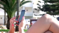 Two videos of woman using mobile phone-real slow motion video
