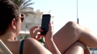 Two videos of woman using phone in real slow motion video