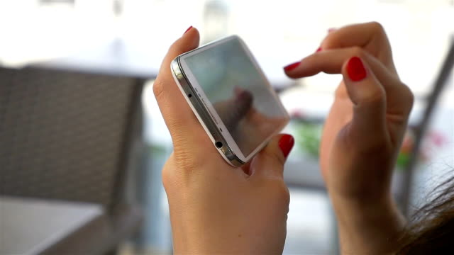 Two videos of woman using phone video