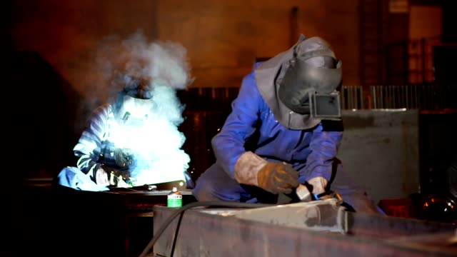 Two welders working video