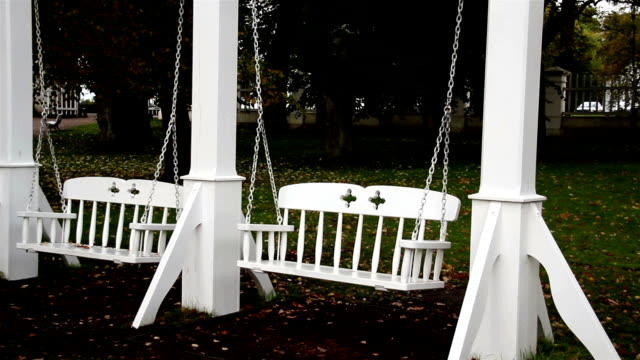Two white bench swing video