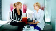 Two women discuss the future procedures in clinic video