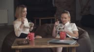 Two women eating dessert video