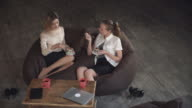 Two women  friend eating delicious dessert with fruts in the cafe video